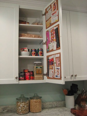 Create a Hidden Cork Board Message Center on the Inside of a Kitchen Cabinet