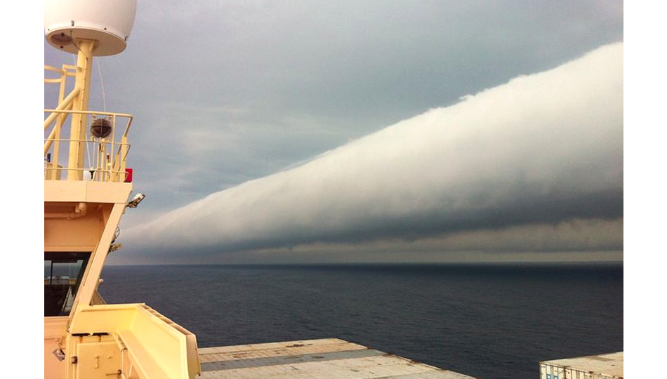 Click here to read Tubular Roll Clouds Look Like a Toppled Tornado