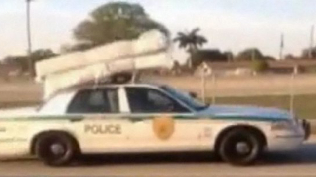 Click here to read Florida Cop Transports Mattress, Box Spring With Squad Car