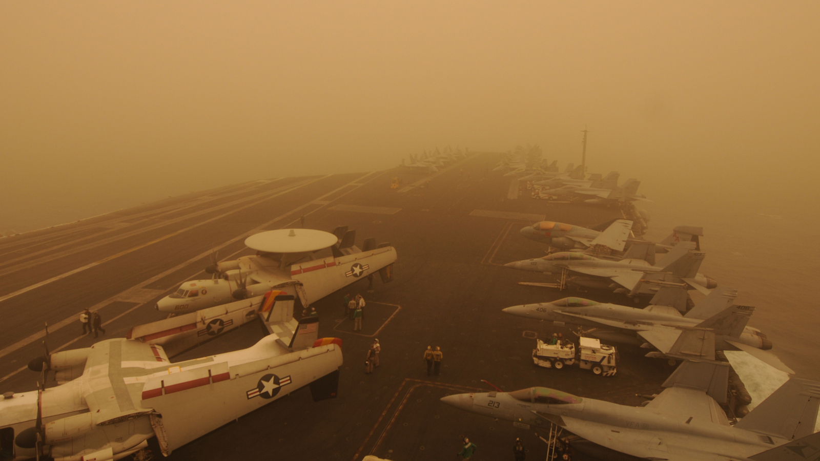 Click here to read How Can This Aircraft Supercarrier Be In the Middle of a Desert Storm?