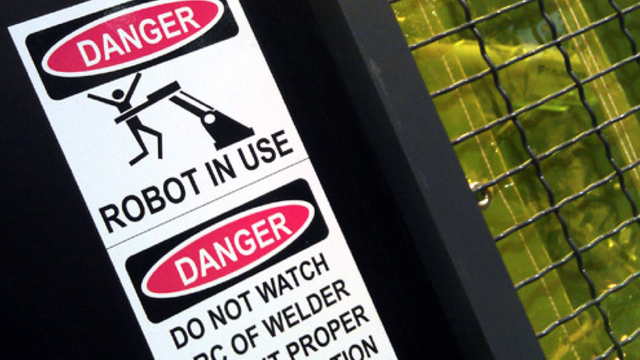 The rise of the machines, as told by workplace safety signs