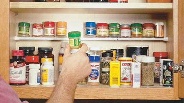 Click here to read Use a Tension Rod To Create a Second Shelf in Your Kitchen Cabinet for Spices