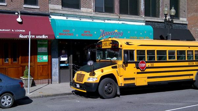 This Is A School Bus Parked In Front Of A Porn Store