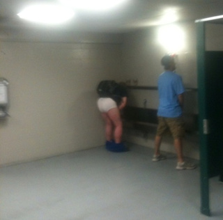 Cubs Fan Struggles With Urinal, Fashion