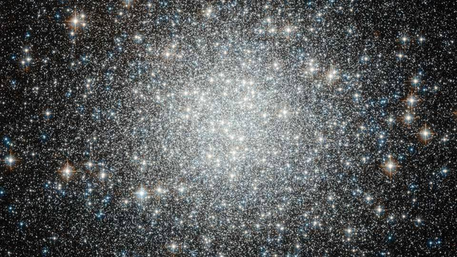 Imagine what it would be like inside this dense cluster of stars