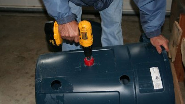 Click here to read Drill a Hole in the Side of Your Garbage Can to Make a Full Trash Bag Easier to Remove