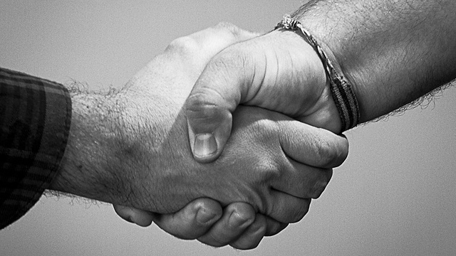 Click here to read Keep Your Hand from Getting Crushed During a Handshake by Touching the Other Person's Wrist