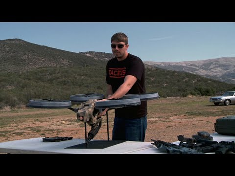Click here to read This Quadrotor Flying Machine Gun Would Kick Serious Ass Some Day