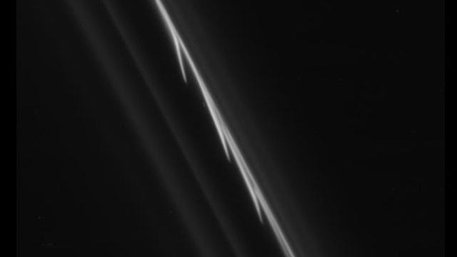 Glittering trails of giant snowballs seen in weirdest ring of Saturn