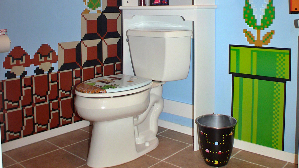 Click here to read Epic Gaming Bathroom Desperately Needs a Warp Pipe Toilet