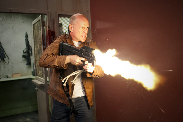Brand New Photos of the Time-Traveling Thriller Looper and the New James Bond Movie!