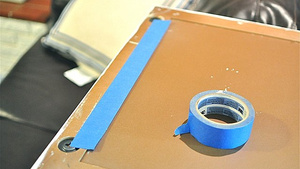 Use a Strip of Tape to Help Hang Pictures Perfectly Every Time