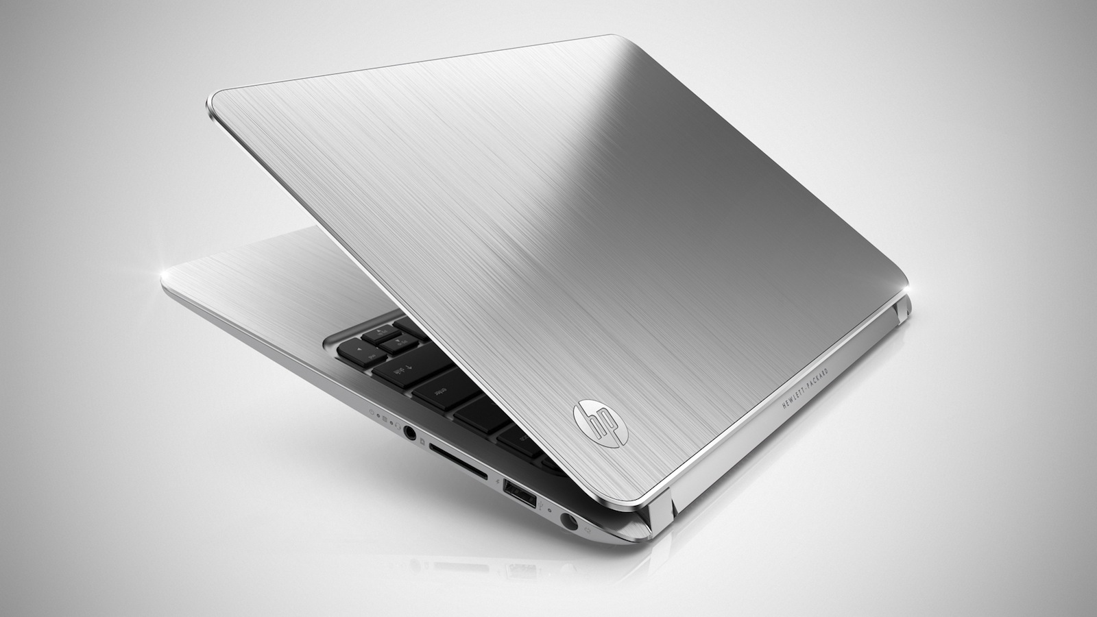 Click here to read HP Spectre XT: HP's Glass Wonder Now Has a Smaller, Cheaper and Aluminum-Clad Sibling