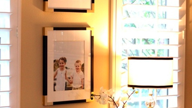 Click here to read Upgrade Your Dull, Boring Frames with Some Painter's Tape and Spray Paint