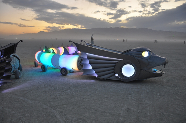And now, two 50-foot-long cars shaped like mythological serpents