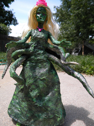 In her dream house at R'lyeh, dead Cthulhu Barbie waits dreaming