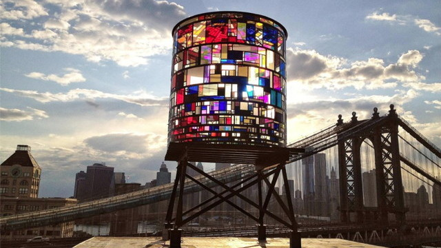 Stained Plexiglas Water Tower Illuminates The Sky In Dazzling Colour