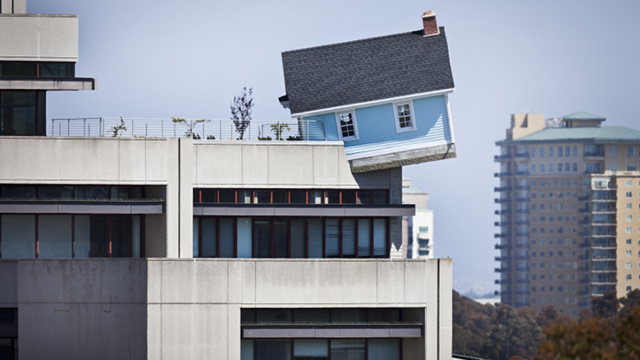 Why Is There Is A House Sprouting From Atop This 7-Story Building?