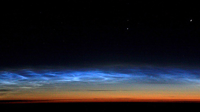 Click here to read Mysterious Electric Blue Clouds Appear Again Over the Poles