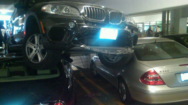 Holy Crap, How Did That BMW Get On Top Of Those Two Cars?