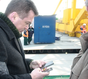Why Might This Russian Politician Be Using Three iPhones At the Same Time?