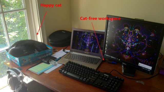 Click here to read Contain Cats at Your Workspace with a Board Game Box