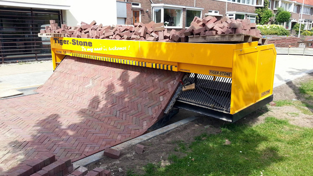 This Machine Prints Brick Roads