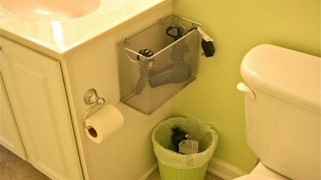 Repurpose a mesh file box into a bathroom appliance holder for Restroom appliances