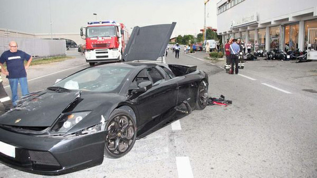 Out Of Control Lamborghini Destroys BMW Motorcycle Dealership