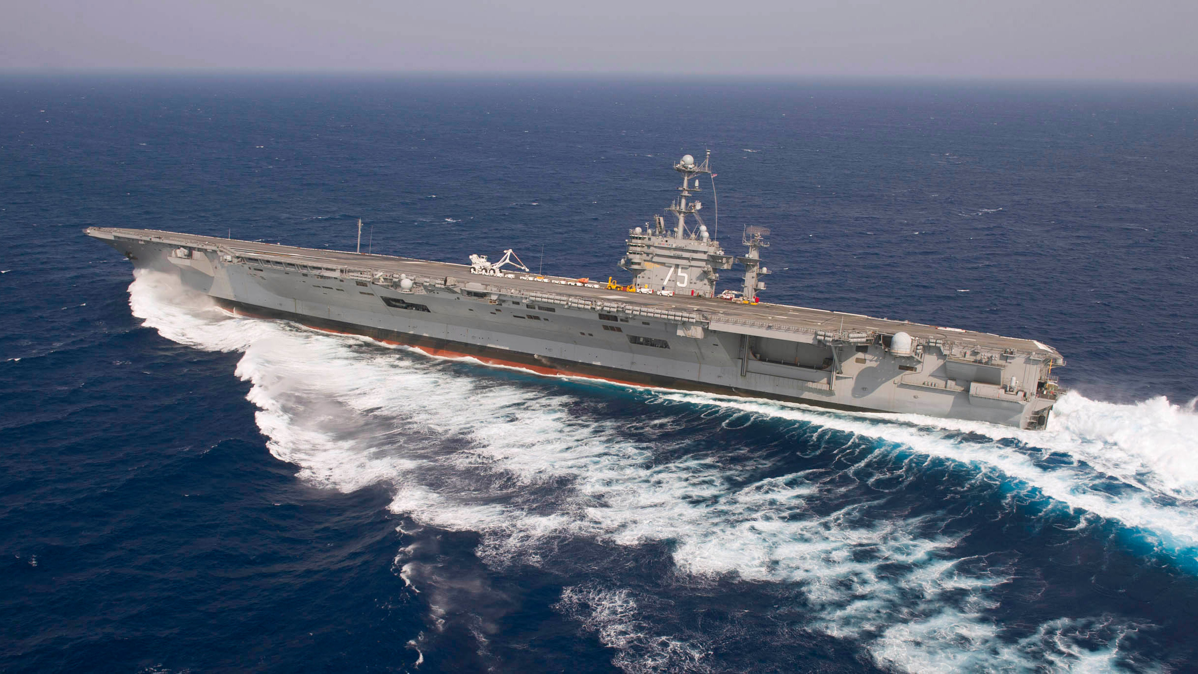 Click here to read Stunning Image of US Navy Nuclear Supercarrier Skidding Like Crazy Over the Atlantic