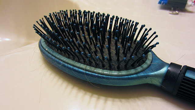 Keep Your Hairbrush Clean with Pantyhose