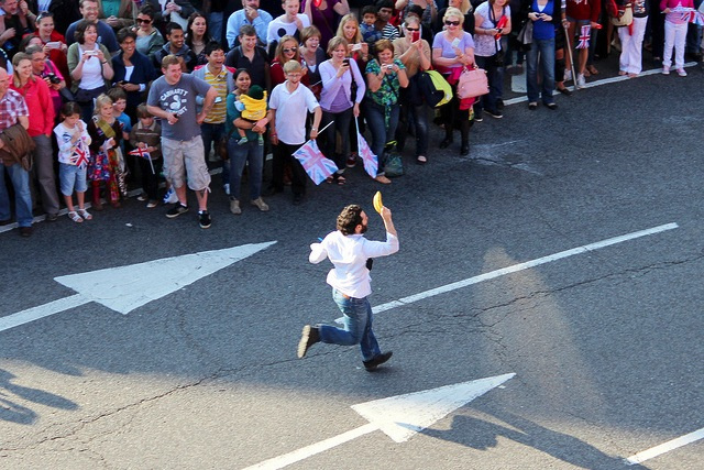 Barricade-Jumping Video Game Developer Runs The Olympic Torch Route With A Banana