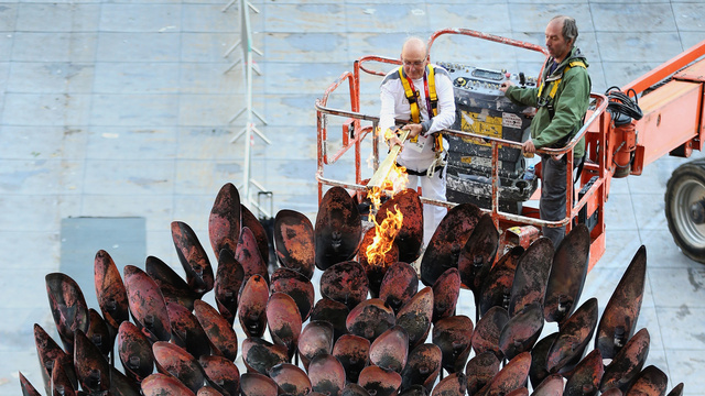 The Olympic Flame Dies, Gets Unceremoniously Relit By Old Guy On a Cherry Picker