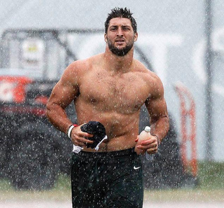 "Tim Tebow ""Didn't Really Think Y'all Would Be Filming"" His Shirtless Run Through The Rain"