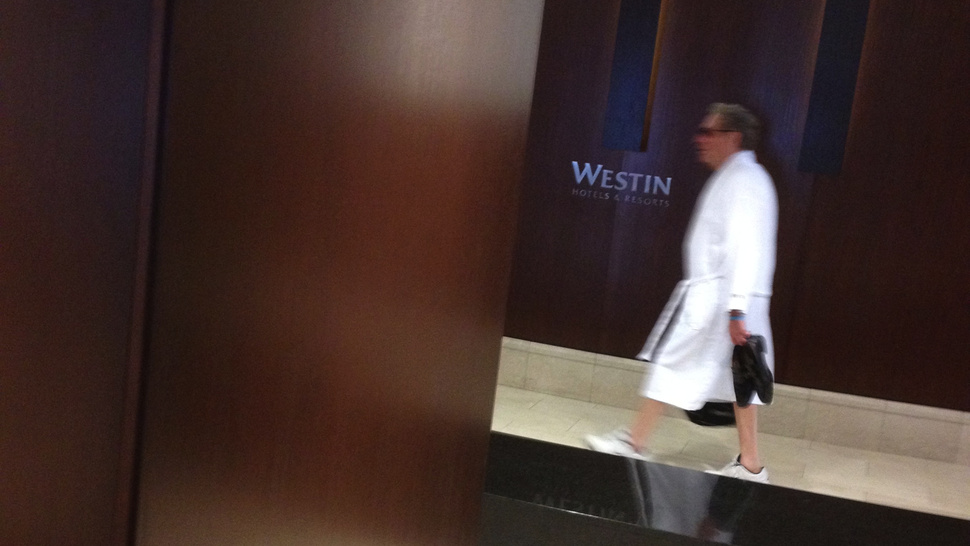 John Sterling Can't Stop Walking Around The Hotel Lobby In His Bathrobe