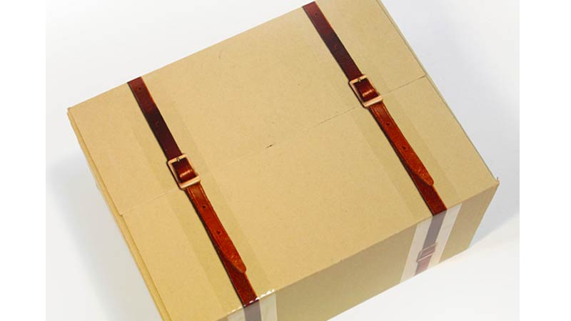 Click here to read Leather Strap Packing Tape Really Classes Up Your Moving Day