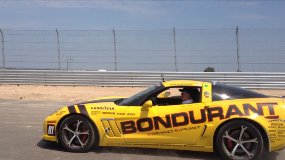 Watch Racing Legend Bob Bondurant Hoon A Corvette Around Austin's F1 Track