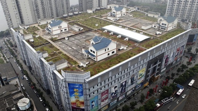 Houses built on a shopping mall roof give residents a yard in the middle of the city