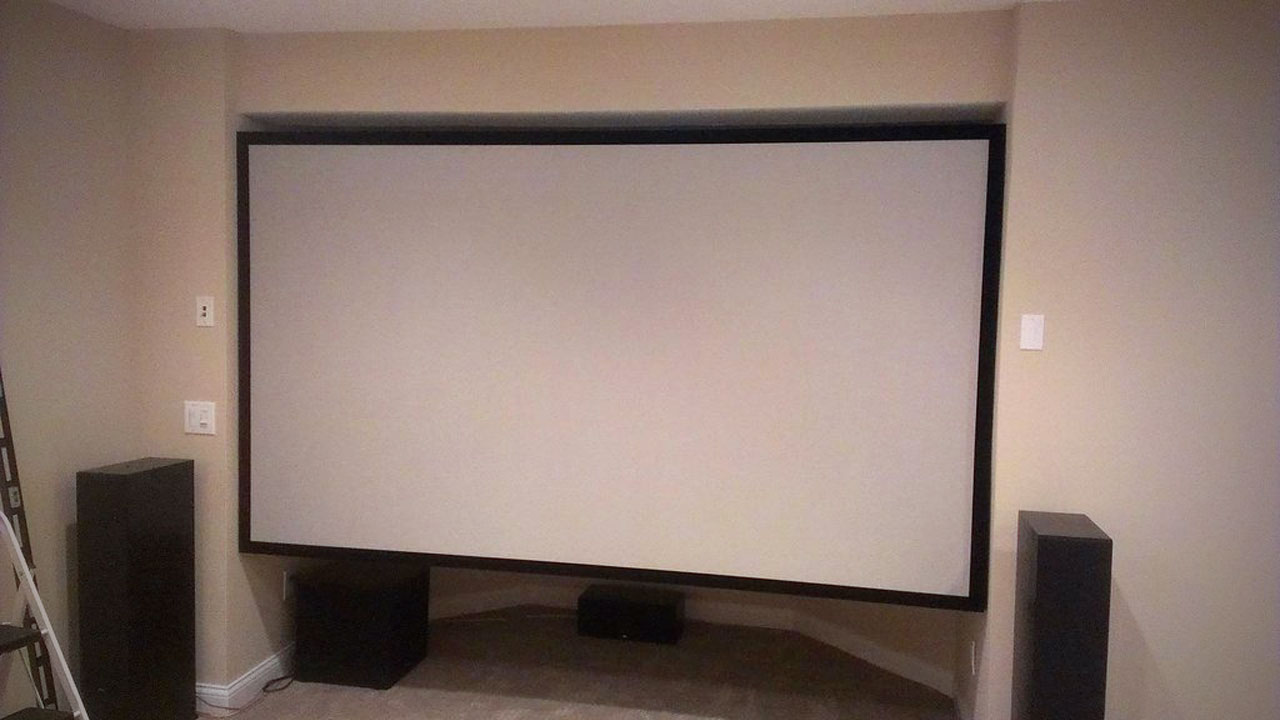 Click here to read Make Your Own Enormous Projector Screen Out of Wood and Spandex