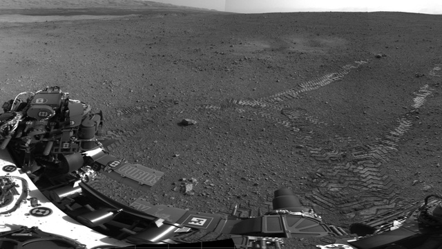 Curiosity makes first tracks on Mars, names its landing site in Ray Bradbury's honor