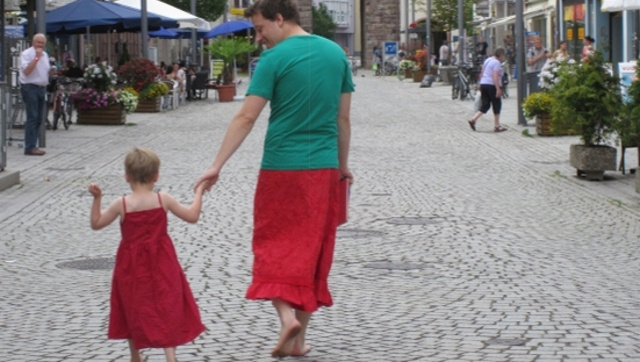 Father of the Year Helps Dress-Wearing Son Feel Comfortable By Putting on a Skirt Himself