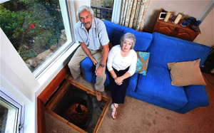 Couple finds medieval well hidden beneath sofa