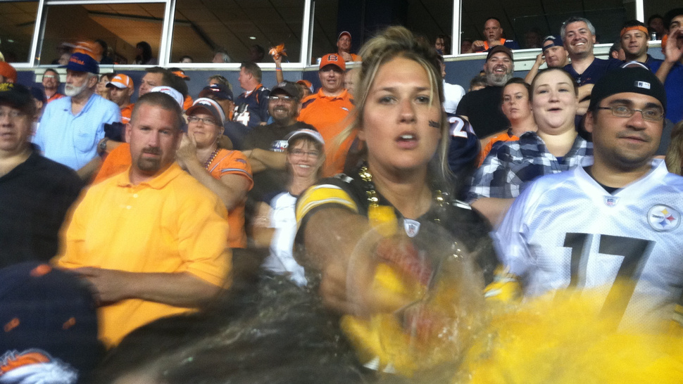 This Photo Captures The Moment A Pissed-Off Steelers Fan Threw Her Beer On The Photographer After Tracy Porter's Game-Ending INT
