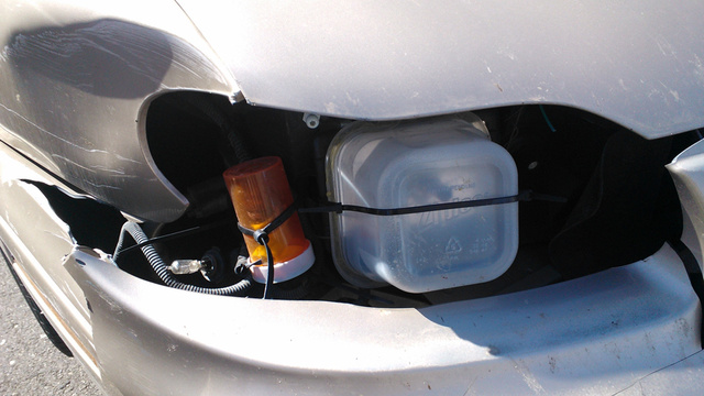 Driver 'Fixes' Headlights With Tupperware And Pills