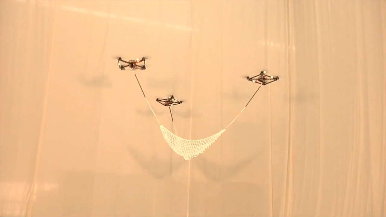 Click here to read This Team of Quadrocopters Can Throw and Catch Better Than You
