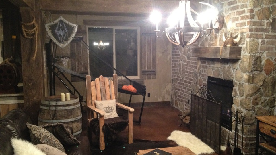 This Comic Book Artist's <em>Skyrim</em>-Themed Basement Is Straight Out of Tamriel