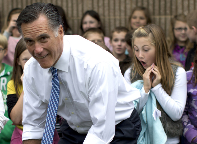 This Photo of Mitt Romney Bending Over in Front of an Astonished Schoolgirl Is Ripe for the Captioning