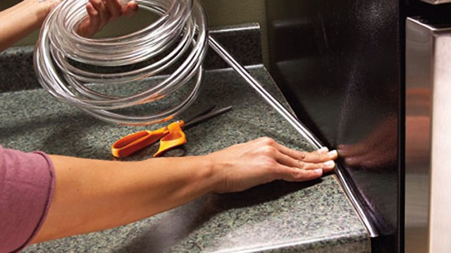 Use Simple Plastic Tubing to Seal the Gap Between Kitchen Countertops and Appliances