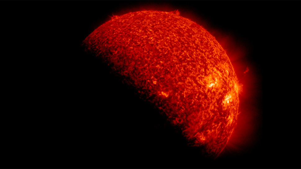 Red Marble: Unreal Portrait of the Sun Eclipsed By Earth