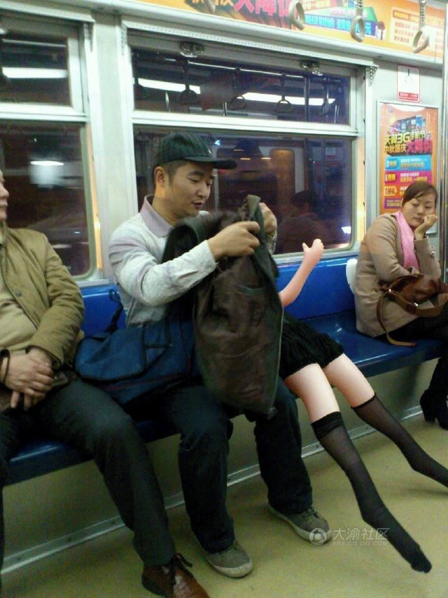 Man Rides the Subway. With a Blow-Up Doll.
